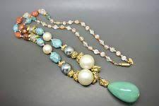 Risultati immagini per collana lunga perle plastica colorata