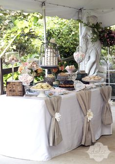 Wedding Dessert Table - La Dolce Dough, Sylvania Ohio.   The secret to a beautiful desert table?  Have things displayed at different levels with cake plates and whatever you can find.    Tallest things in the back.