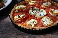 Tomatoes in a tart shell with herbs and goat cheese.