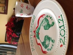 Santa's plate and cup for milk and cookies.  Child's footprints and thumbprints.