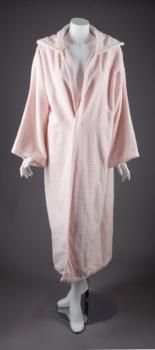 """A robe worn by Marilyn during the filming of """"The Prince and the Showgirl"""", 1957. A pink terry cloth robe worn by Marilyn while she was in make-up and off set. """"Property From the Estate of Marilyn Monroe,"""" Julien's Auctions"""