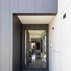 ZINNIA II   Step inside through this custom pivot door. This door was lined in the same material as the walls so when closed it disappears into it's surrounding environment.   Designed by @reitsmaassociates   #DLC #design #build #construct #architecture #home #house #door #polishedconcrete #custom #light    @cemintel barestone