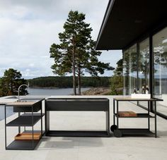 A modern outdoor kitchen & charcoal grill by Swedish designers Johan Ridderstrale & Mat Broberg for Roshults.First seen here:http://remodelista.com/posts/the-worlds-most-elegant-outdoor-grill.Roshults website:http://roshults.se/