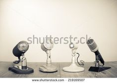 Retro old microphones on table. Vintage style sepia photo
