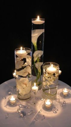 37 Mind-Blowingly Beautiful Wedding Reception Ideas [love candles and flowers in water] How beautiful are these Floating Candle Centerpieces With Flower ! They are inexpensive and gorgeous Simple but amazing !They are wonderful for wedding or Wedding Reception Ideas, Wedding Table Decorations, Wedding Table Numbers, Wedding Tables, Wedding Receptions, Candle Decorations, Low Budget Wedding, Reception Food, Decor Wedding