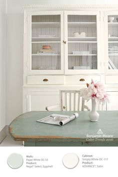 Refresh and recycle an old China Cabinet with Benjamin Moore ADVANCE paint in our Color of the Year 2016 'Simply White OC-117'. It offers an elegant look when combined with the distressed pale green table. #ColorTrends2016
