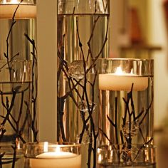 Twigs and glass baubles in water with floating candles. this is literally THE ONLY centerpiece with floating candles and water that DOESN'T make me want to vom. Water Candle, Candle Vases, Candle Wicks, Clear Vases, Unity Candle, Glass Candle, Thanksgiving Centerpieces, Thanksgiving Table Decor, Thanksgiving Wedding