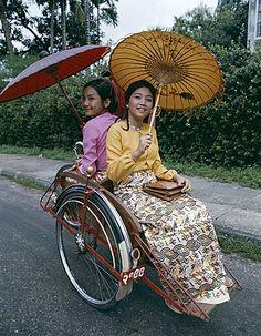 Women dressed in traditional clothes in rickshaw, Yangon, Myanmar (Burma), Asia