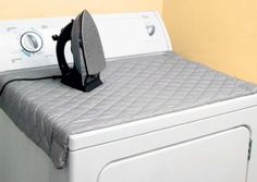 It turns your washing machine (or any metallic surface) into an easily tuck-away-able ironing board.