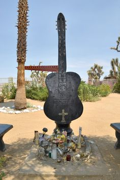 The memorial outside Room 8 at the Joshua Tree Inn, with items left as tribute to Gram Parsons