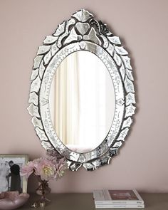 """Venetian-inspired mirror with decorative cuttings and etchings on all perimeters. Made of wood composite and glass. 20""""W x 0.75""""D x 30""""T. Hooks on back for hanging. Imported. Weight 7 lbs. Boxed weigh"""