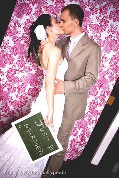 Wedding photo booth with chalkboard.