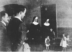 WWII. - 1942. - NDH - Jastrebarsko - Croatian officials and Ustasa militia view a group of children in the care of nuns at the Jastrebarsko concentration camp.