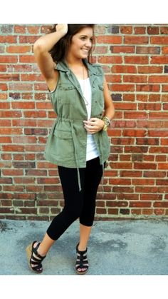 "Sgt. Sass $50.00 You don't have be a celeb to dress like one!  Sleeveless utility style jackets are HOT, HOT, HOT for Fall!  So easy to throw on & go while looking effortlessly chic!  We love the military star detail embroidered on this jacket & the tie string waist which can give a more fitted look.  Pair with our ""Show Your Stripes"" Maxi skirt or dark denim skinny's for a casually glam look! www.southernswankboutique.com Call us! (252)462-5906"