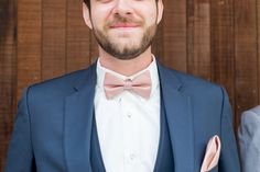 groom with coral pink bowtie and navy suit by Cavin Elizabeth Photography