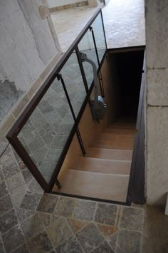 Idea for scary garage steps. Need to secure step area while providing light and security. Basement Entrance, Basement Windows, Basement Stairs, House Stairs, Garage Steps, Trap Door, Cellar Design, Underground Bunker, Safe Room