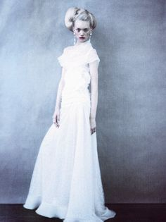 Gemma Ward is an angelic beauty as she wears a pure white fluffy gown from the Valentino Haute Couture Spring/Summer 2004 collection in an editorial fittingly titled 'Just Enchanting' which was shot by the dark and dreamy photographer Paolo Roversi...