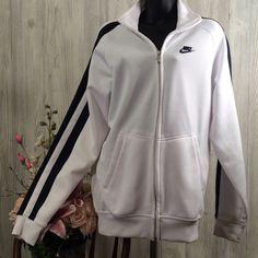 Men's Nike athletic jacket White and navy blue. Full zipper. Two front pockets. Excellent condition no flaws. Nike Tops Sweatshirts & Hoodies