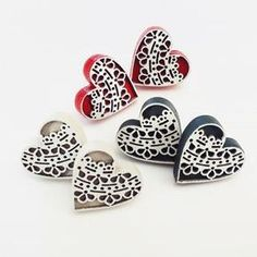 Landi Kuhn - Functional Art & Design Plywood Earrings with laser cut detail Each heart is x Available in 3 colours - Navy, Beige & Red.