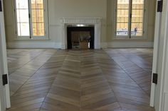 Floors by Renaissance Parquet (Melbourne). Chevron cut at 35 degrees with bevel. The French Oak was fumed and brushed with a wax finish, this installation was made over a hydronic heated slab