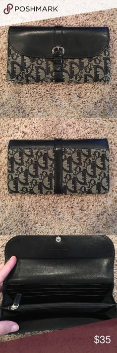 """Dior wallet Reposh!  Navy and tan. In good condition. A little worn on the ends. 6 credit card slots, one bill slot, zippered center and one open area. Snap works great. Needs a good home.  7.5"""" long, 4"""" tall. Dior Bags Wallets"""