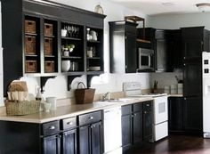 Painted Black Kitchen Cabinets kitchens - black kitchen cabinets wicker baskets white wainscoting