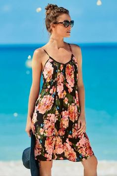 """Add flirty florals into your summer wardrobe with this gorgeous Black Hydrangea dress from Next."""