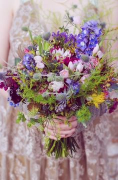 Wild flowers arranged in a rustic bouquet #wedding #flowers #fall #autumn #bridalbouquet