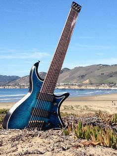 """Master Built - Ring Master headless ergo 8. Built in Arroyo Grande CA by Gene Baker b3 guitars     28-26.5 scale fan fret 24 frets 20"""" radius Neck shape offset airplane wing .800-.900 T4M tuners/saddles/locks Bartolini pickups custom preamp Vol (coil split), mid boost, tone control with treble boost/bass cut Mahogany/Maple body Wenge, maple, purple heart neck, Rosewood, set neck 2 way truss rod graphite reinforced RB Continental gig bag"""