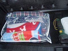 Old bedding bag holding blankets (and dryer sheet) in tucked in the back of the car until needed (sick or wet kids/ pets, protect the seats). Add towels for wet playground/picnic areas.