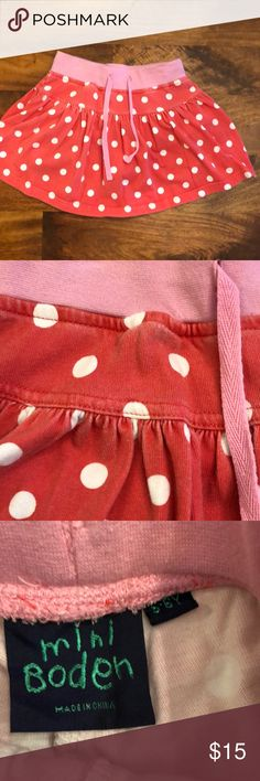 Mini Boden cotton jersey skirt Rich coral color with pink waist band. Some fading - please see pictures. Built in shorts. Slight folding of the elastic in the waistband. Size 5-6. Mini Boden Bottoms Skorts