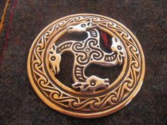Anglo Saxon brooch- This reminds me of my friend Adena.  I know they are dragons or horses, but they look like giraffes.
