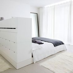 I always loved the way a bed can look good when placed in the middle of a room