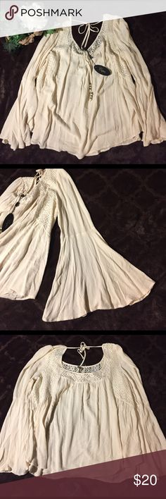 NWT Cupio Bell Sleeve Lace Cream Top, XL New with tags. XL, cream color. 100% Viscose. Cupio Tops Tunics