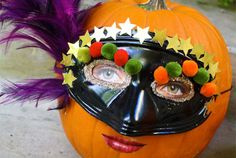 Masquerade pumpkin - No-Carve Pumpkin Decorating Ideas for Kids I Halloween Crafts for Kids - ParentMap
