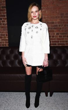 Kate Bosworth in a jewel-embellished fur tunic, mini skirt, and tall over-the-knee black boots