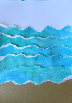 torn painted paper + sand paper. Have kids finger paint blue paper then tear into wave shapes: