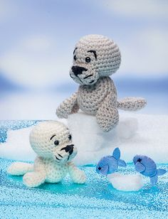 Who could resist falling in love with this adorable harp seal and her pup! For an extra-fluffy harp seal, try using a fuzzy DK- or sport-weight yarn (like mohair or angora) and give him a good brushing all over with your pet slicker brush to loosen up the yarn fibers. Don't forget to check out the fish pattern in the book for when it's dinnertime for your seal family. They'll be glad you did!