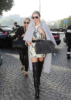 Miranda Kerr in a Balenciaga dress and skirt, Hermes over the knee boots, a Balmain bag and a grey cape during Paris #fashionweek Spring 2014 collections
