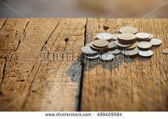 Thai baht coins. Coins on wooden texture under morning sunlight.