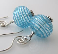 blue swirl glass and sterling bead earrings hand worked