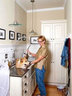 Keep Him Clean - Mudrooms aren't just for humans anymore. A deep farmhouse sink is just right for Wilson the Corgi or your smallish pooch. A restaurant-style sprayer works well, but a pullout faucet will do.