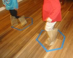 """Learners in Bloom: Rain-Themed Preschool Activities - """"Splash"""" in """"puddles"""" with paper bag """"boots"""""""