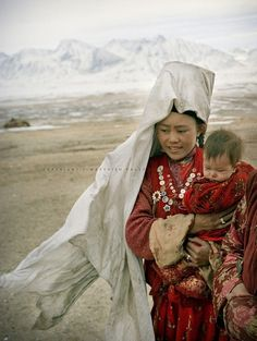 "Afghanistan | Portrait of a Kyrgyz mother and child. | ©Matthieu Paley. ""Forgotten on the Roof of the World - Afghanistan's Pamir. 