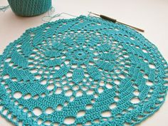 sew ritzy~titzy: a doily with peacock thread