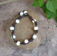 Gentle white beads like pearls. Today it is hard to find a true friend like it's hard to find pearls. Symbolically decorate your bracelets with these beads.