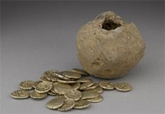 The stunning hoard of 32 Celtic gold coins was found in a field near Henley, Oxfordshire. The coins date from roughly the time of Julius Caesar's two short-lived invasions in the 50's BC. They were minted by the Atrebates, probably at Silchester.  The image of the horse is likely to have had a special significance for the inhabitants of Oxfordshire in the Iron Age. It is highly reminiscent of the White Horse on the Ridgeway.