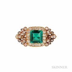 Antique Gold, Emerald and Diamond Brooch, centering a 2.64 carat step-cut emerald surrounded by old European-, old mine-, and rose-cut diamonds.
