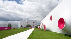 Berlin-based firm Magma Architecture designed the truly unforgettable shooting ranges for the London 2012 Olympic Games and the Paralympic Games. Composed of three temporary tent-like structures that are covered in a white PVC membrane that is broken up with brightly colored circular openings.
