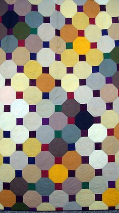 City Fair quilt by Cherri House via Flickr. Traditional snowball quilt, set on the diagonal, colored to emulate strings of outdoor lights from a distance